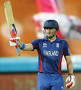 Luke Wright raises his bat after reaching fifty