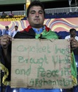 An Afghanistan supporter holds a placard