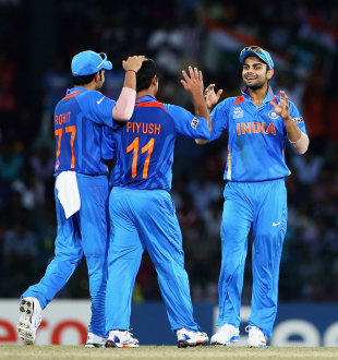Piyush Chawla takes the plaudits from Rohit Sharma and Virat Kohli, England v India, World Twenty20, Group A, Colombo