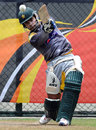 Umar Akmal goes for the big hit in the nets