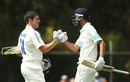 Moises Henriques is congratulated by Trent Copeland on reaching 150