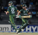 Umar Gul and Umar Akmal cross for a run