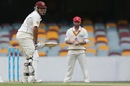 Usman Khawaja faces up while Phillip Hughes watches from slip