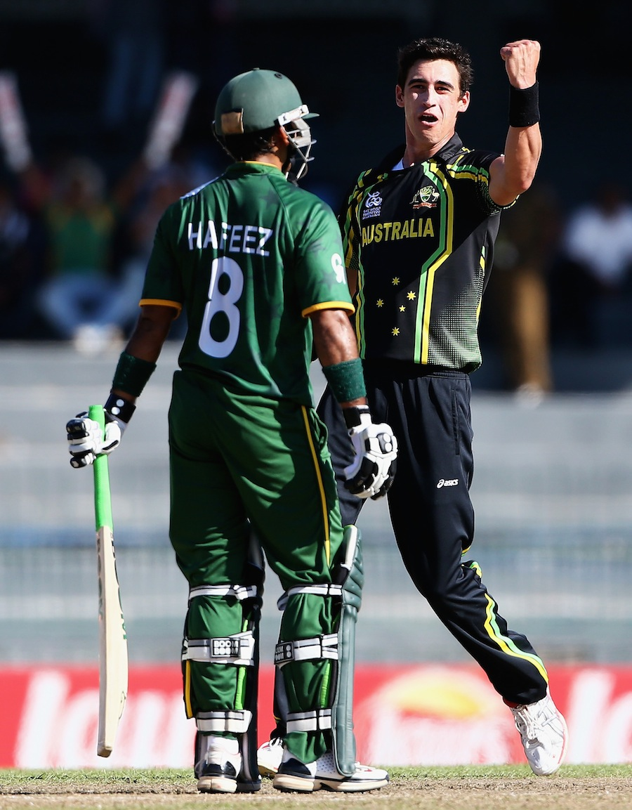 Mitchell Starc is pumped after picking up the wicket of Mohammad Hafeez