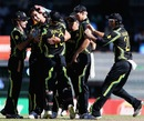 Mitchell Starc is mobbed by team-mates