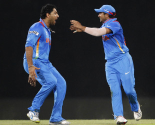 Yuvraj Singh and Suresh Raina celebrate AB de Villiers' wicket, India v South Africa, Super Eights, World Twenty20, Colombo, October 2, 2012