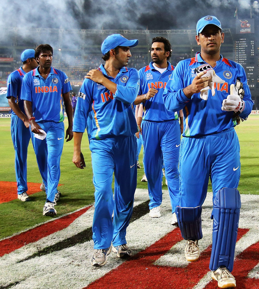 MS Dhoni leads his side from the field having won the game but been knocked out