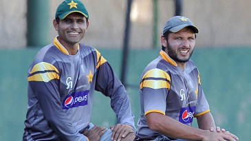 Shahid Afridi and Abdul Razzaq stretch during a training session