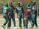 Nehemiah Odhiambo and his team-mates celebrate a wicket