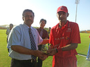 Hong Kong's Nizakat Khan receives his second Man of the Match award after scoring 33 and claiming 3-35 against Kuwait at the ACC Trophy Elite 2012 in Abu Dhabi