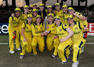 Australia pose with the trophy after winning the Women's World T20; they beat England by 4 runs in the final