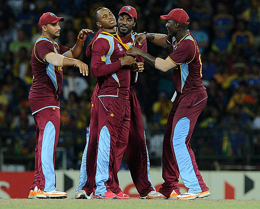 Marlon Samuels is mobbed by his team-mates