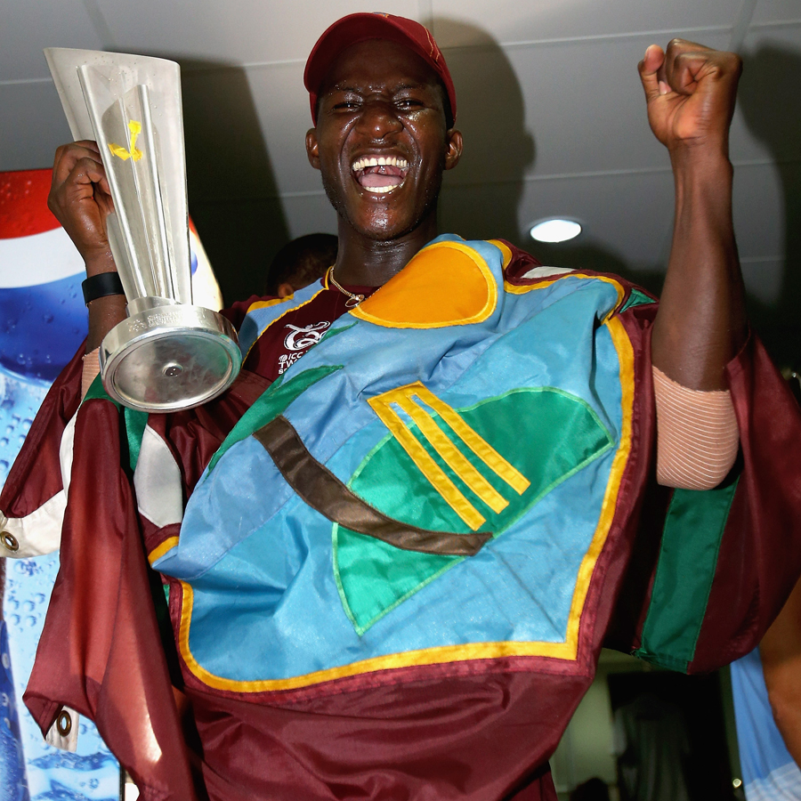Darren Sammy with the West Indies flag and the trophy after winning the World Twenty20 title
