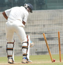Murtuja Vahora loses his middle stump to Rishi Dhawan, North Zone v West Zone, quarter-final, Duleep Trophy, 3rd day, Chennai, October 8, 2012