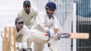 Parthiv Patel sweeps during his half-century