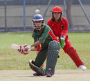 Priya Jain (KCC Maidens) and Natural Yip (HKCC Cavaliers) keep their eyes on the ball during their Women's T20 Cup match at Mission Road on 14th October 2012
