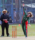 Sarah Eames lets one go while Atif Hussain looks on during a Women's T20 Cup match at Mission Road on 14th October 2012