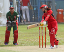 Natural Yip and Reenu Gill in action during the 3rd/4th play-off match in the Women's T20 match at Mission Road on 14th October 2012