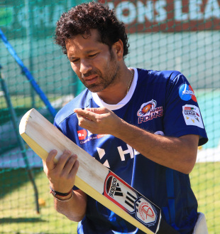Sachin Tendulkar inspects his bat during training, Champions League T20, Cape Town, October 17, 2012