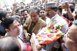 Nazmul Hassan, the new BCB president, is greeted by board directors and party supporters at the board's headquarters in Mirpur, October 19, 2012