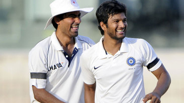 Mohammad Kaif congratulates Jalaj Saxena on a wicket