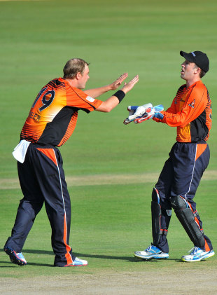 Michael Beer celebrates a wicket with Luke Ronchi, Auckland Aces v Perth Scorchers, Champions League T20, Centurion, October 23, 2012