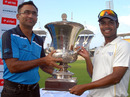 East Zone captain Natraj Behera lifts the Duleep Trophy handed over by Saba Karim