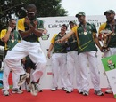 South African players dance on the podium after winning the Hong Kong Super Sixes, Hong Kong, October 28, 2012