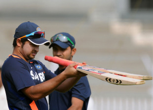 Suresh Raina inspects bats during a practice session ahead of India A's game against England, Mumbai, October 29, 2012