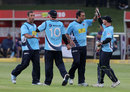 Auckland Aces celebrate a wicket