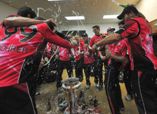 The Sydney Sixers celebrate after completing a commanding CLT20 campaign with a ten-wicket win in the final against Lions