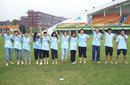 Student volunteers at the Guanggong International Cricket Stadium in Guangzhou, India v Sri Lanka, women's Twenty20 Asia Cup, 1st semi-final, Guangzhou, October 30, 2012