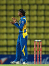 Akila Dananjaya applauds a fielder, Sri Lanka v New Zealand, Twenty20 international, Pallekele, October 30, 2012