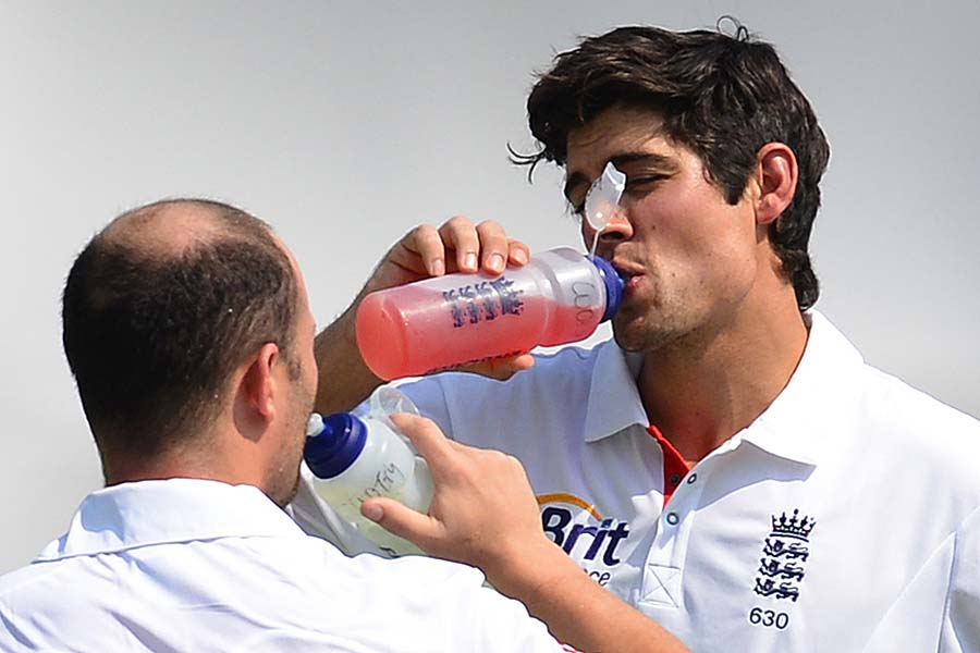 Alastair Cook and Jonathan Trott take a break during play