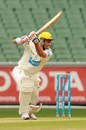Michael Hussey drives one through point