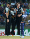 Tim Southee celebrates a wicket with Ronnie Hira and Kyle Mills
