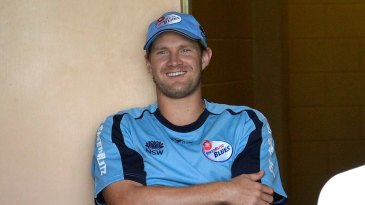 Shane Watson rests his sore calf in the dressing room