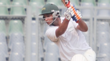 Mahesh Rawat drives enroute to his half-century