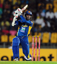 Upul Tharanga plays a shot on one knee