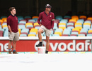 The groundstaff wait for a decision on the play, Australia v South Africa, 1st Test, Brisbane, 2nd day, November 10, 2012