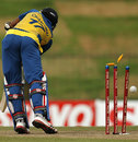 Dinesh Chandimal is bowled by Tim Southee
