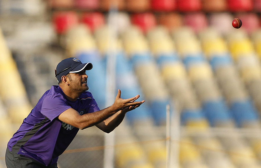 MS Dhoni prepares to catch a ball during practice