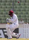 Denesh Ramdin avoids a bouncer