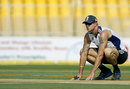 Kevin Pietersen inspects the pitch ahead of the Ahmedabad  Test