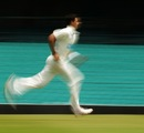 Mitchell Starc runs in to bowl