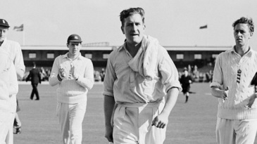 Jim Laker walks back after taking all ten wickets