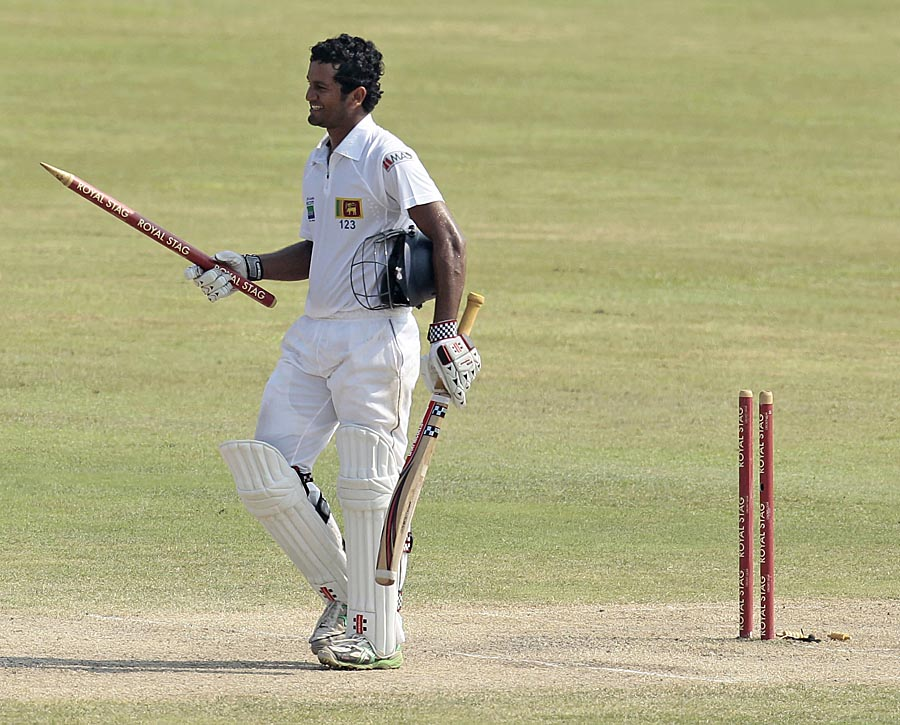 Dimuth Karunaratne takes off a stump after taking Sri Lanka to victory