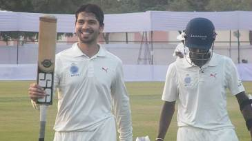 Naman Ojha walks back after scoring a century against Rajasthan