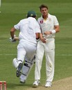 Graeme Smith and James Pattinson brush against each other