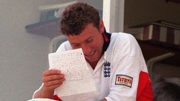 Mike Atherton reads a letter